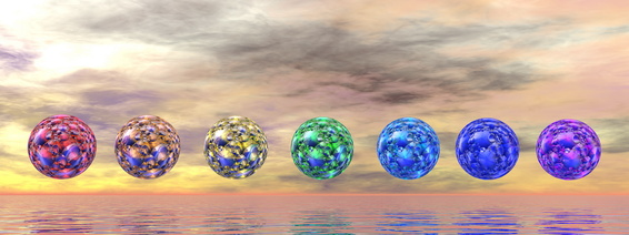 Colorful chakra spheres by sunset - 3D render